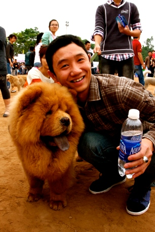 A happy man and his blue tongued Chow Chow