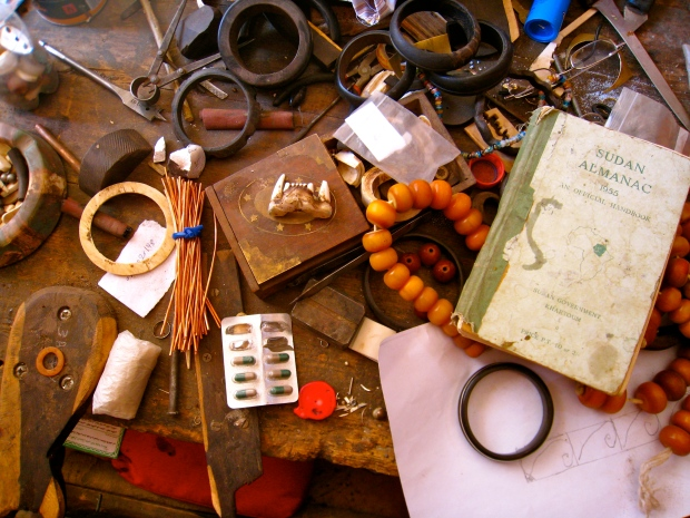 Bulbul's cluttered desk, one of the few remaining guildsmen in Omdurman. I particularly like that he still has a 1956 edition of the Sudan Almanac.