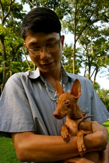 A boy and his miniature pinscher, which looked rather like a Cirneco Dell'Etna