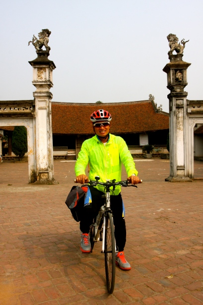 Mr. Phong in front of the village Communal Hall