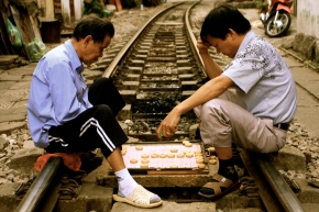 Taking it easy and playing 'Chinese' Chess on the railway tracks