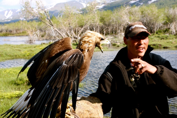 A mongolia and his beautiful Golden Eagle which was getting a bit grumpy!